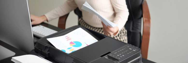 Female employee printing documents