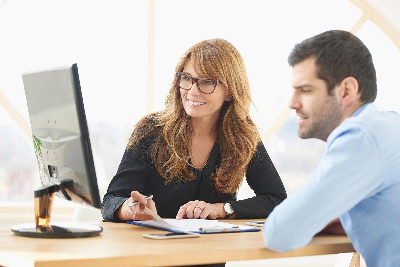 businesswoman-sitting-at-desk