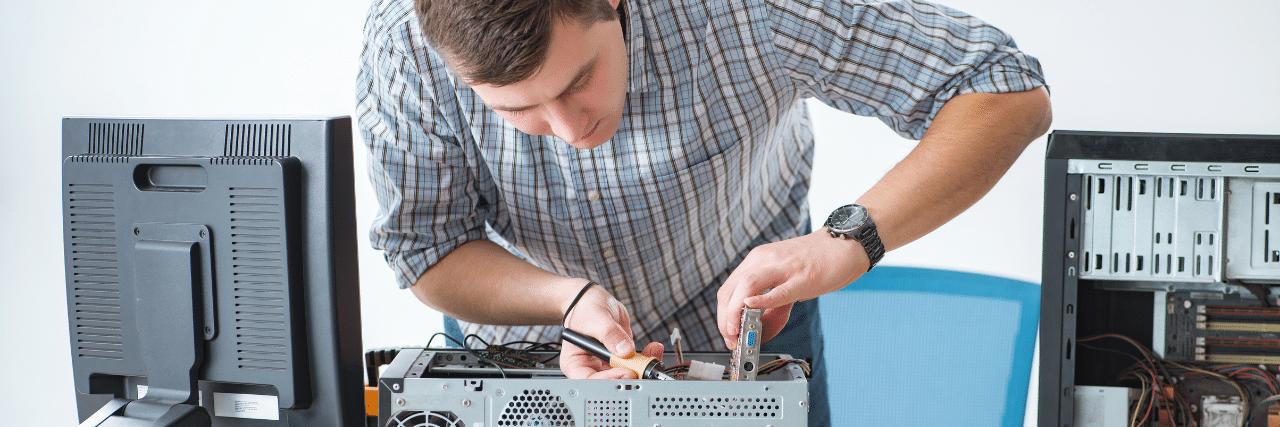 Computer technician assembling a workstation